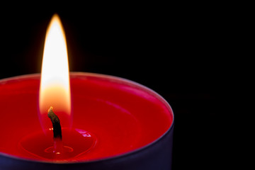 Dark glowing red tea light