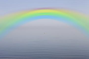 Rainbow over calm lake