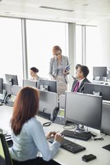 Business people working in an open plan office