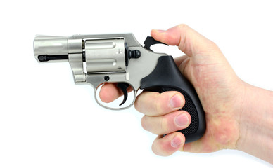 Hand holding gun on white background.