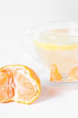 Orange mandarin or tangerine fruit and lemon tea