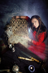 mature woman with owl making black magic