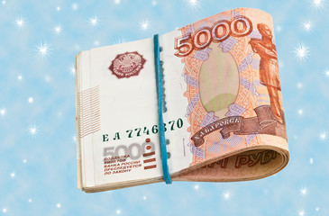 Russian 5000 rubles bank note on a blue background