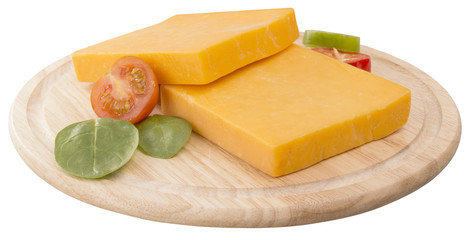 two slices of cheddar on wooden board decorated with cherry and