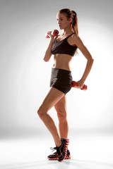 Sporty woman doing aerobic exercise