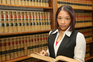 Young Female Lawyer in Law Library