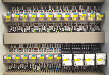 Relay panel with relays and wires closeup