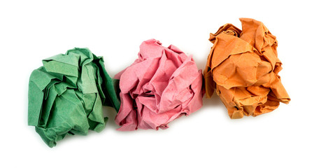 Crumpled balls of multi-colored bright paper isolated on white