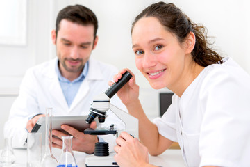 Scientist and his assistant in a laboratory