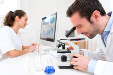 Scientist and her assistant in a laboratory