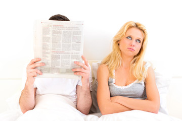 Young woman bored while her boy reading news