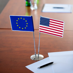 table with two flag usa and eu