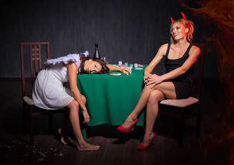 Angel and devil with drugs