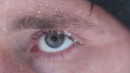 blur man Eye with snowflake closeup