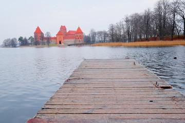 pier in the background of Trakai Castle