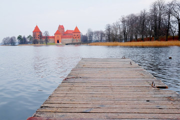 pier in the background of Trakai Castle