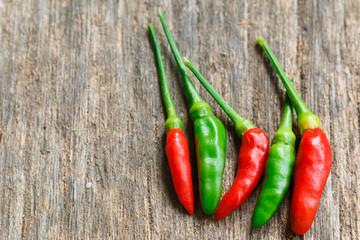 Hot green and red chili or green and red chilli pepper  on old w