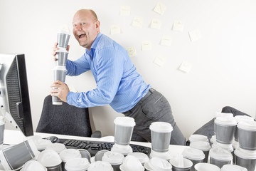 Happy businessman drinks too much coffee