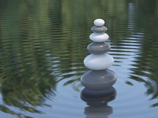 Dark and white Zen stones in a lake