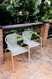 Out door couple of rattan chairs.