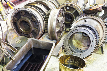 gears of disassembled motor in mechanical turnery
