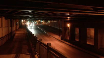 Traffic at night passing under an underpass