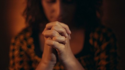 Hand gestures. Woman praying to god.