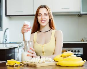woman cooking milkshake with bananas and milk