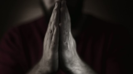 Hand gestures. Man praying to god. Black and White