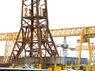 tower and bridge cranes in metal product warehouse