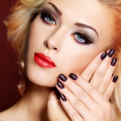 Beautiful  woman with black nails and red lips