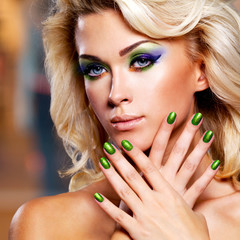 Beautiful woman with green nails
