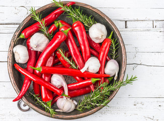 Red hot chili peppers on white wood background, fresh spices.
