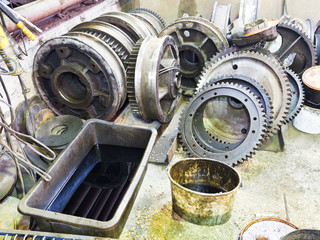 gears of disassembled engine in workshop