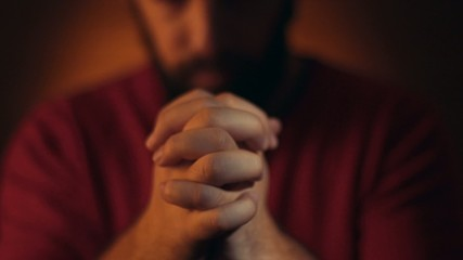 Hand gestures. Man praying to god.