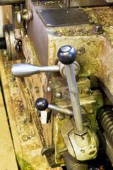 handles of metal lathe machine close up