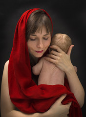 Beautiful woman in red love hug newborn baby black background