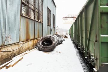 reinforcement rolls near warehouse on railroad