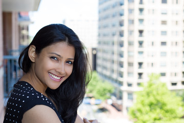 Closeup portrait, woman on balcony