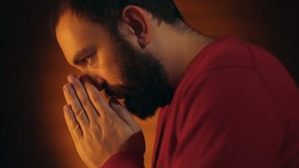 Hand gestures. Man praying to god.