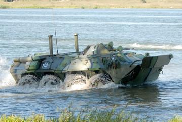 Russian APC BTR-80 crossing the river on maneuvers.