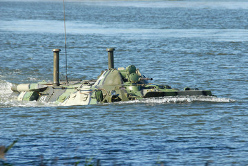 Russian APC BTR-80 crossing the river on maneuvers.