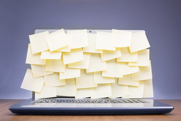 Post-its attached to laptop