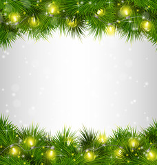Yellow Christmas lights on pine branches on grayscale background
