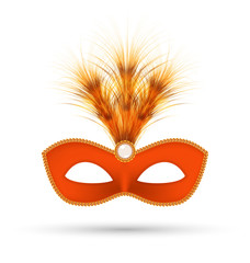 Orange carnival mask with fluffy feathers isolated on white back