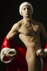 athlete with Christmas balls, naked and sexy