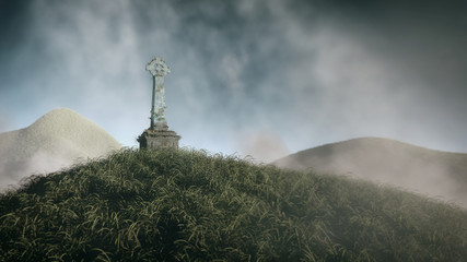 Grass hill with celtic cross from stone. Cloudy sky.