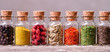 spices in bottles - 74610984