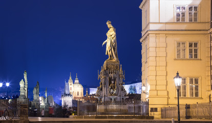 Night view of statue on the Charles Bridge in Prague