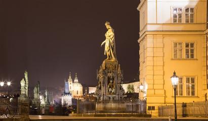 Night view of statue on the Charles Bridge in Prague